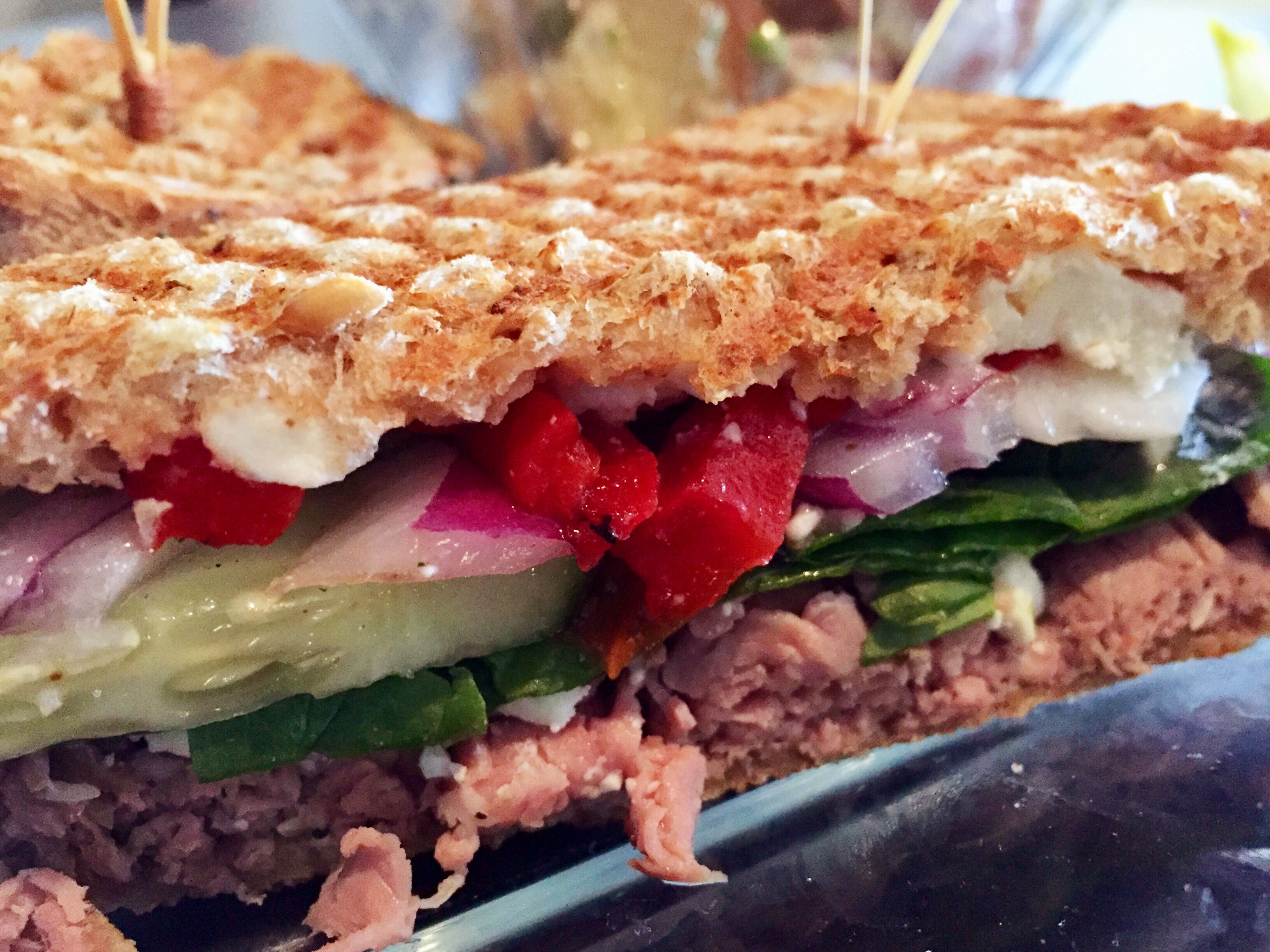 deco deli bar eating out jeff jones fed sliced roast beef topped feta cheese cucumber red onion roasted red pepper and greek dressing sp on panini pressed wheat b